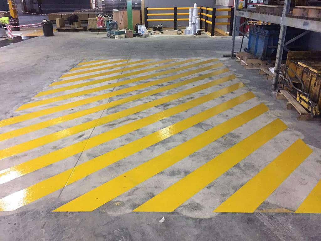 Hazard markings painted on warehouse floor