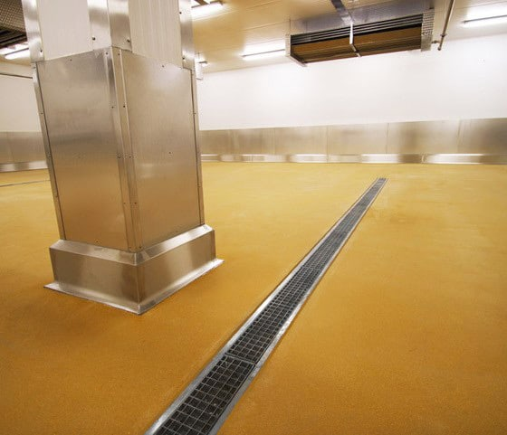 Yellow resin floor at Regal Foods with drainage